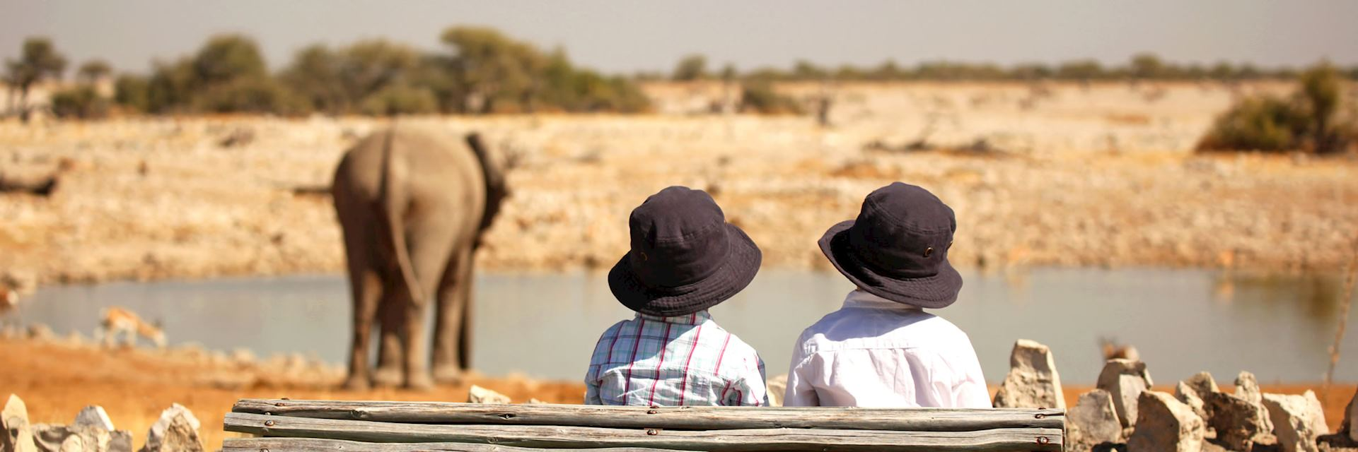 Children at the Okaukuejo Waterhole in Etosha National Park