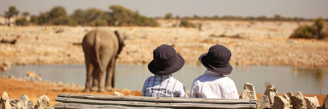 Children at the Okaukuejo Waterhole in Etosha National Park