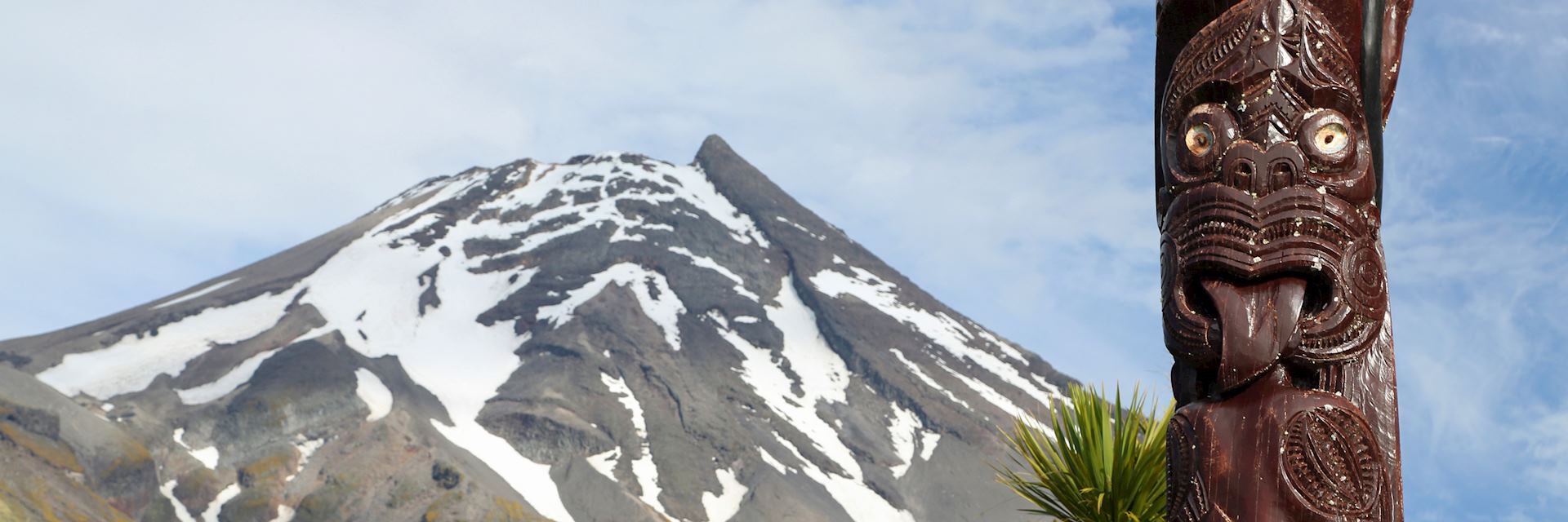 Maori carving against Volcano Taranaki
