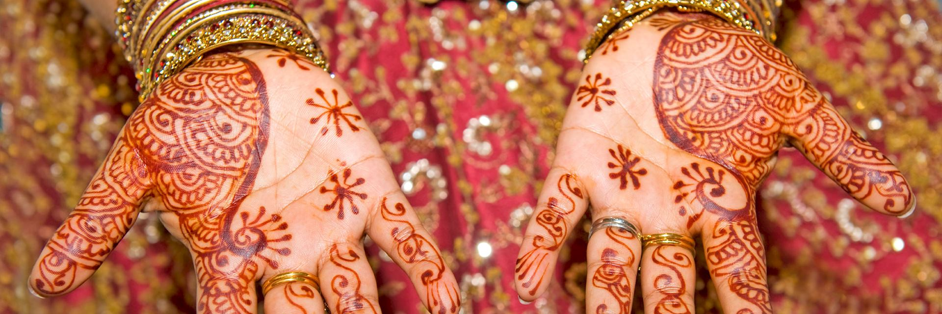 Indian lady's hands covered in henna