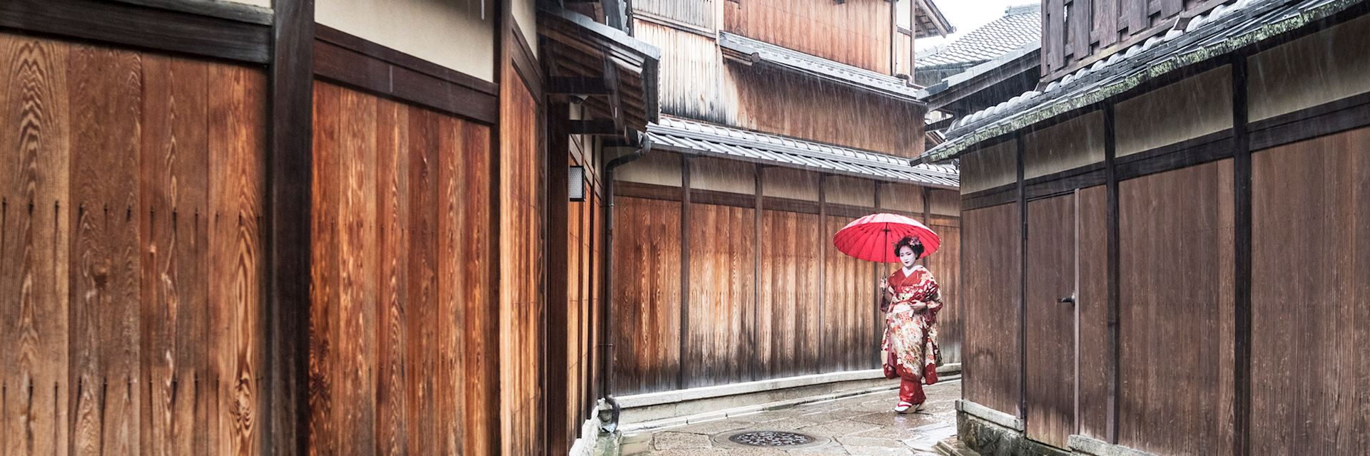 Geisha walking through a Japanese village
