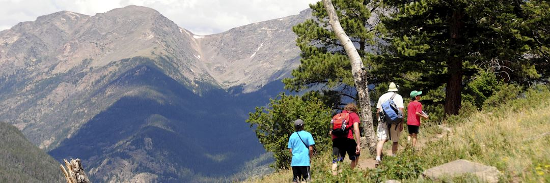 Family hiking in the Rocky Mountains National Park in Colorado, USA