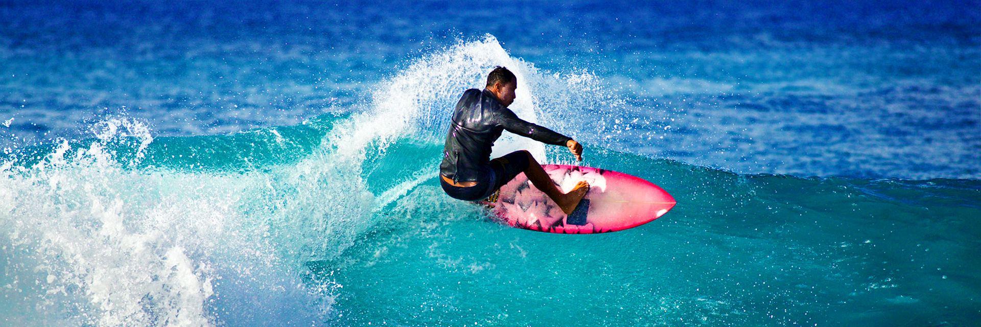 Surfer off the coast of Kauai, Hawaii