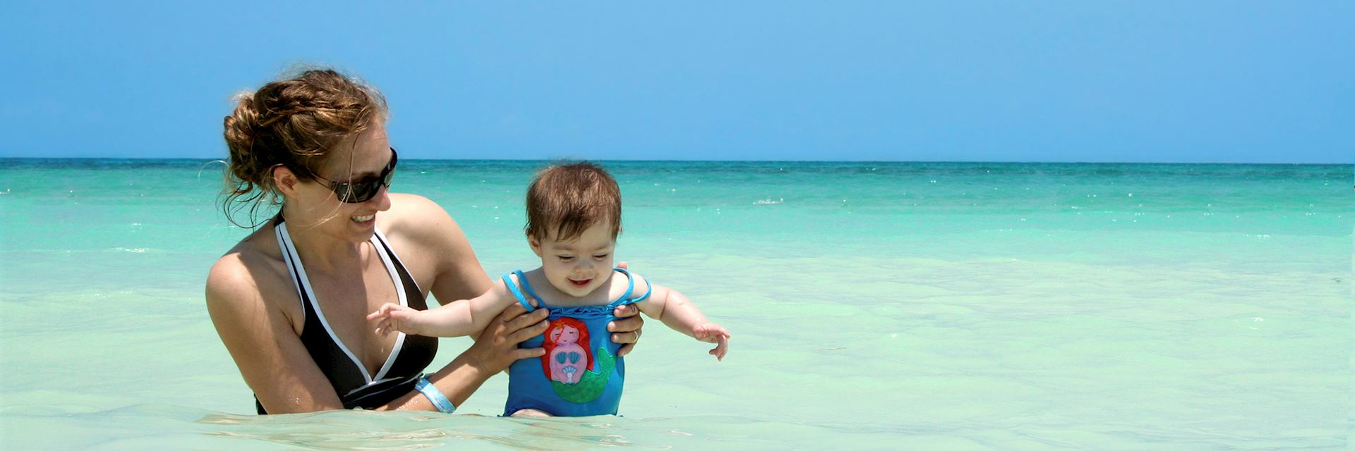 A family enjoying time in the waters off Belize