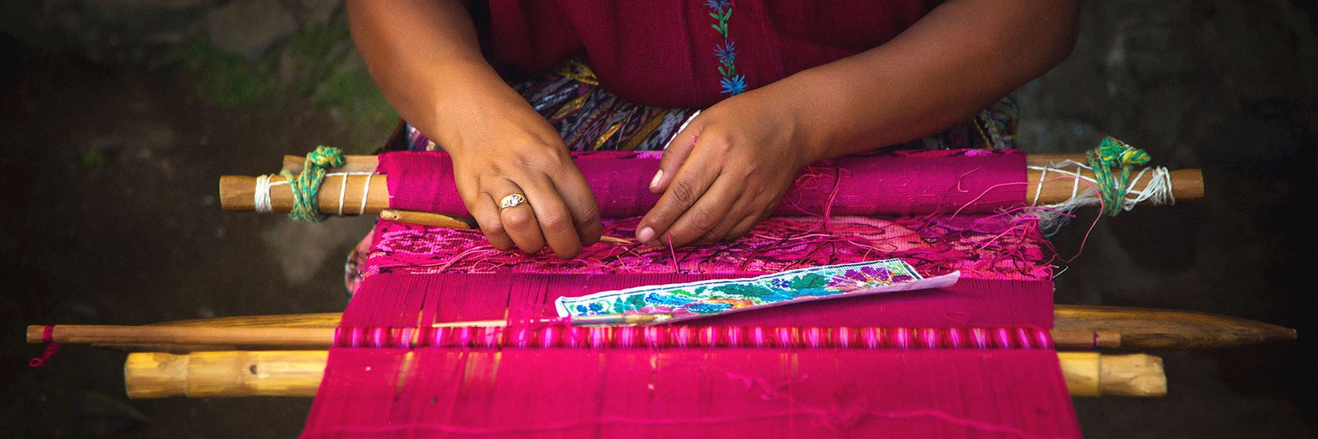 Woman weaving on a loom in Guatemala