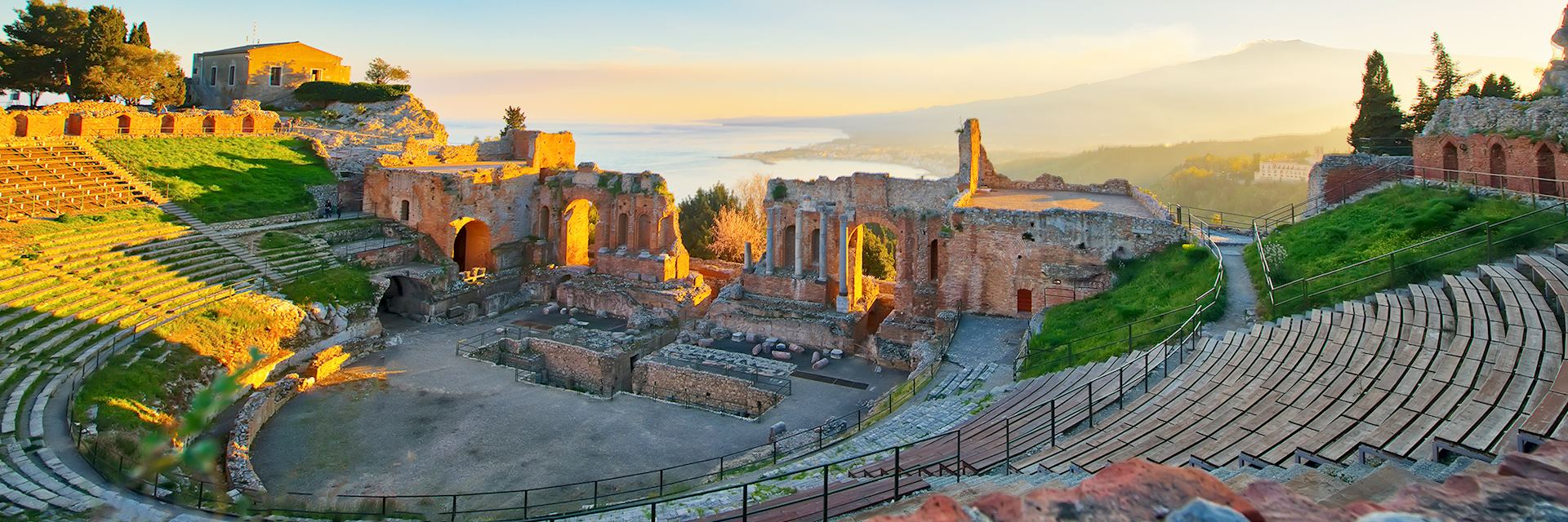 Ancient theatre of Taormina with Etna in the distance