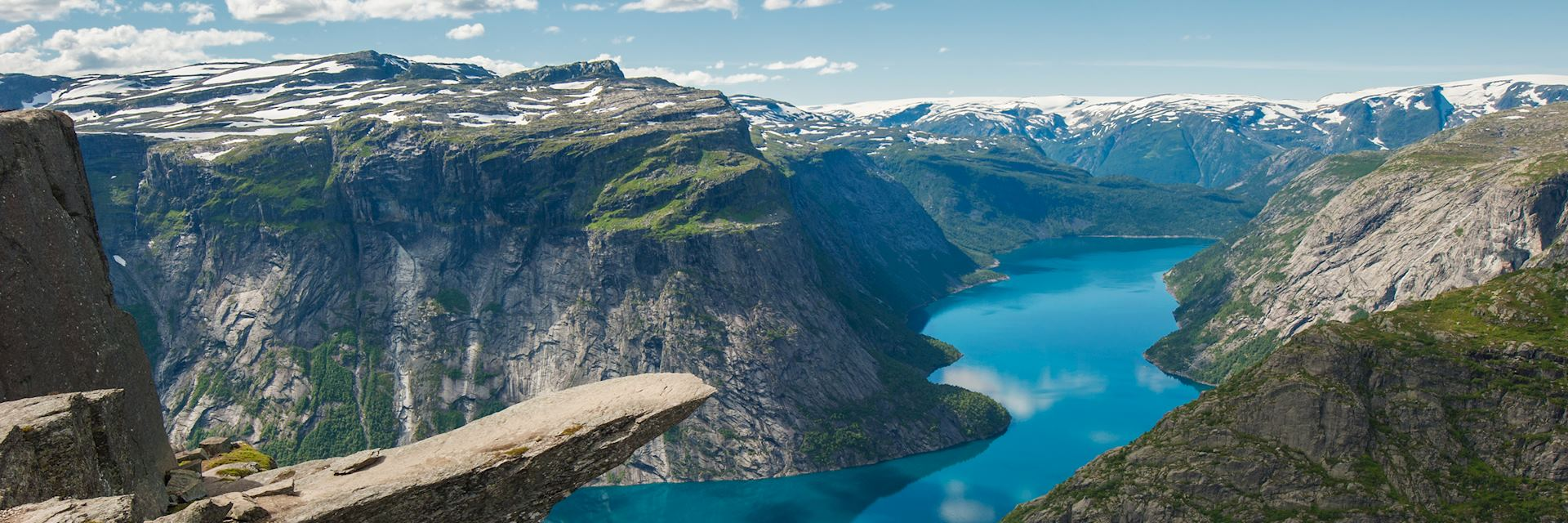 The rock formation of Trolltunga above lake Ringedalsvatnet