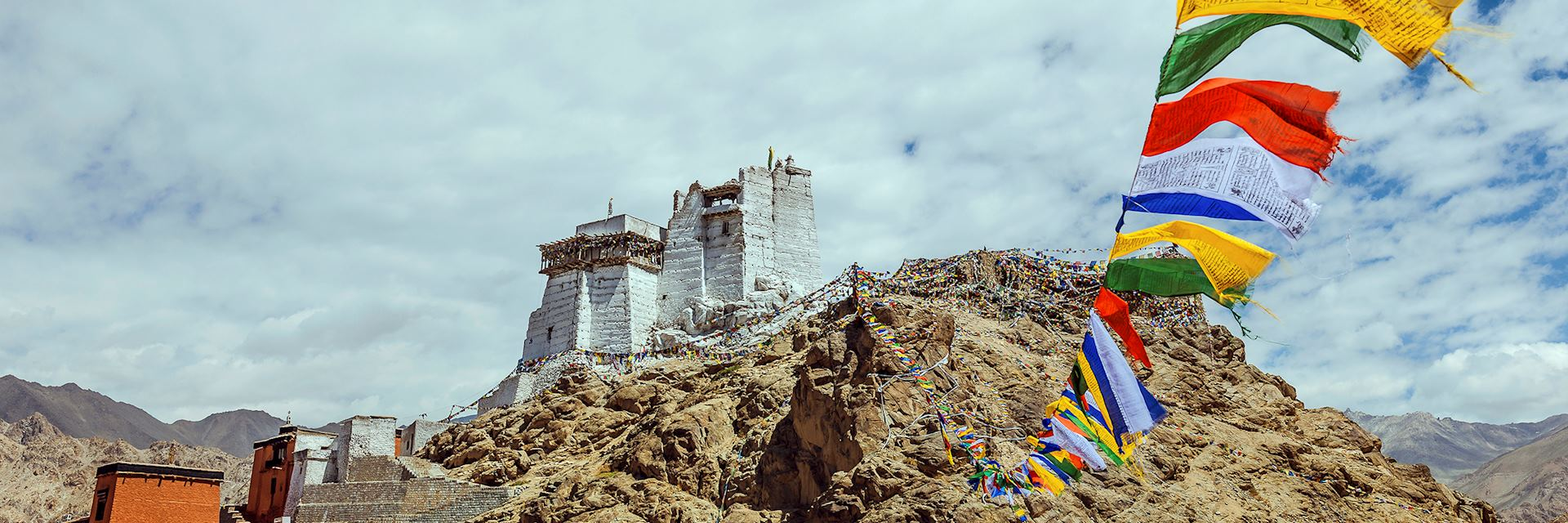Prayer flags and Leh Palace in Ladakh, northern India