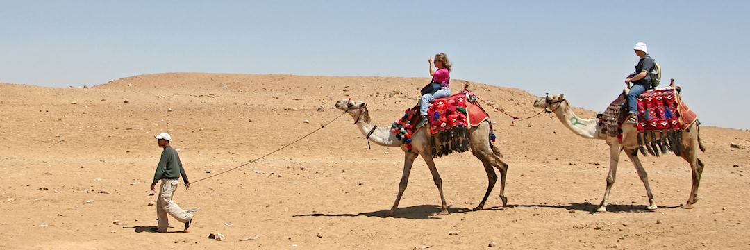 Couple on camels in Egypt