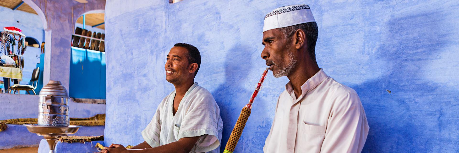 Nubian men smoking a waterpipe