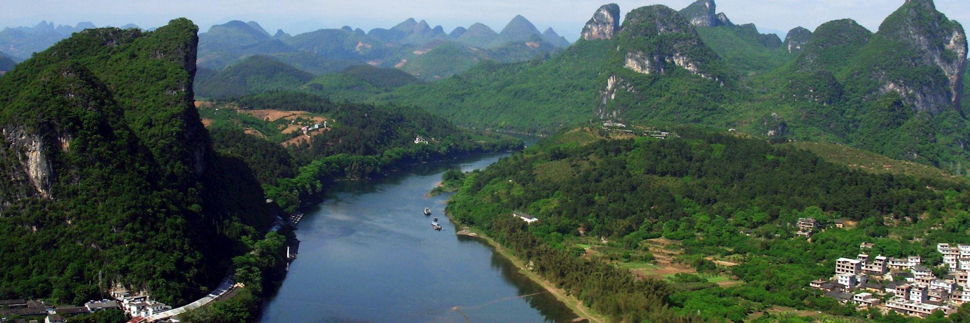 Cruise through the limestone pinnacles in Yangshuo