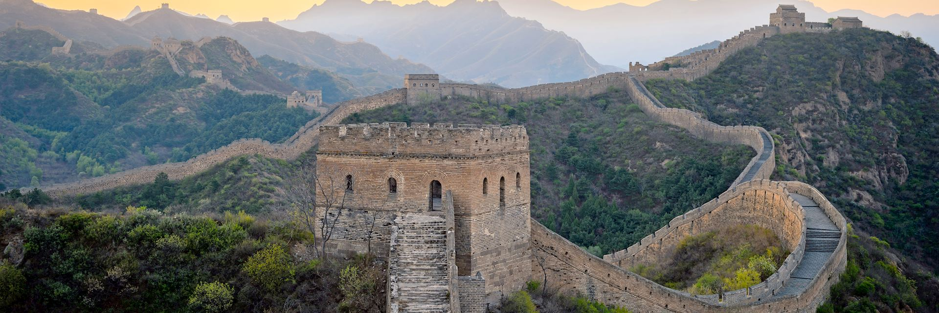 Dawn breaking over the Great Wall of China in Jinshanling