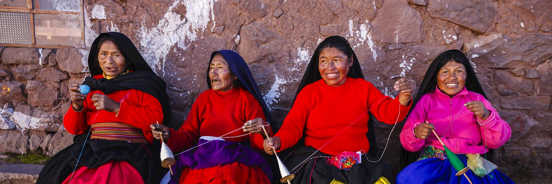 Women spinning wool on Taquile Island, Lake Titicaca, Peru