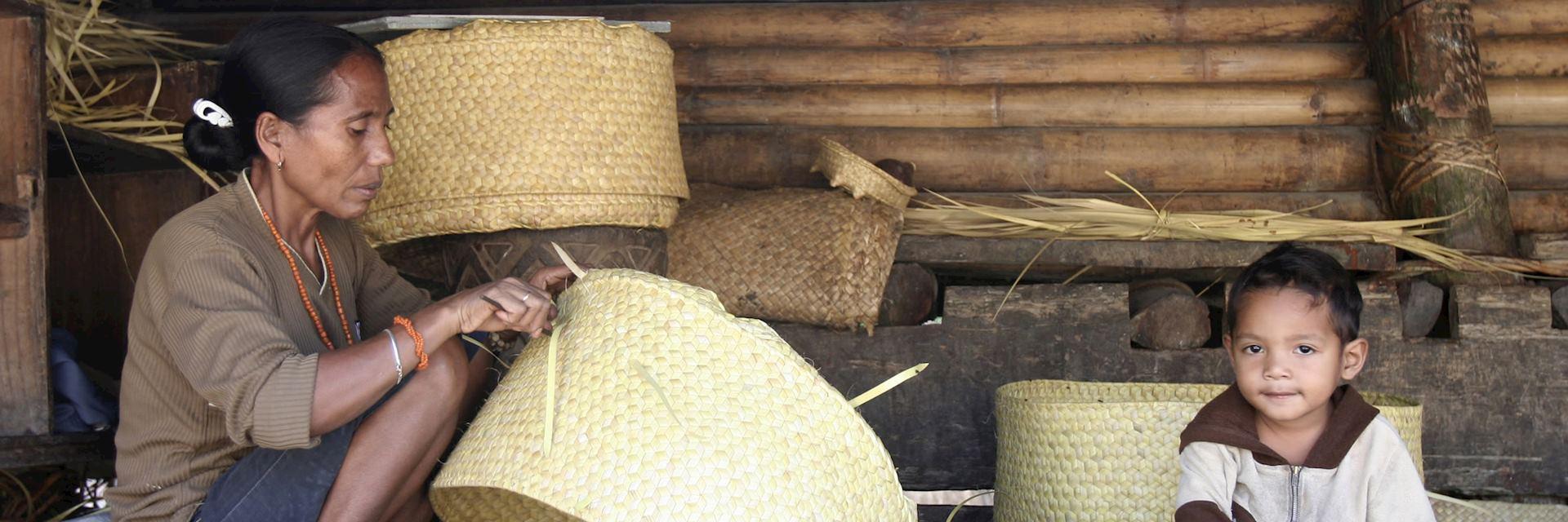 Woman weaving a basket, Sumba, Indonesia