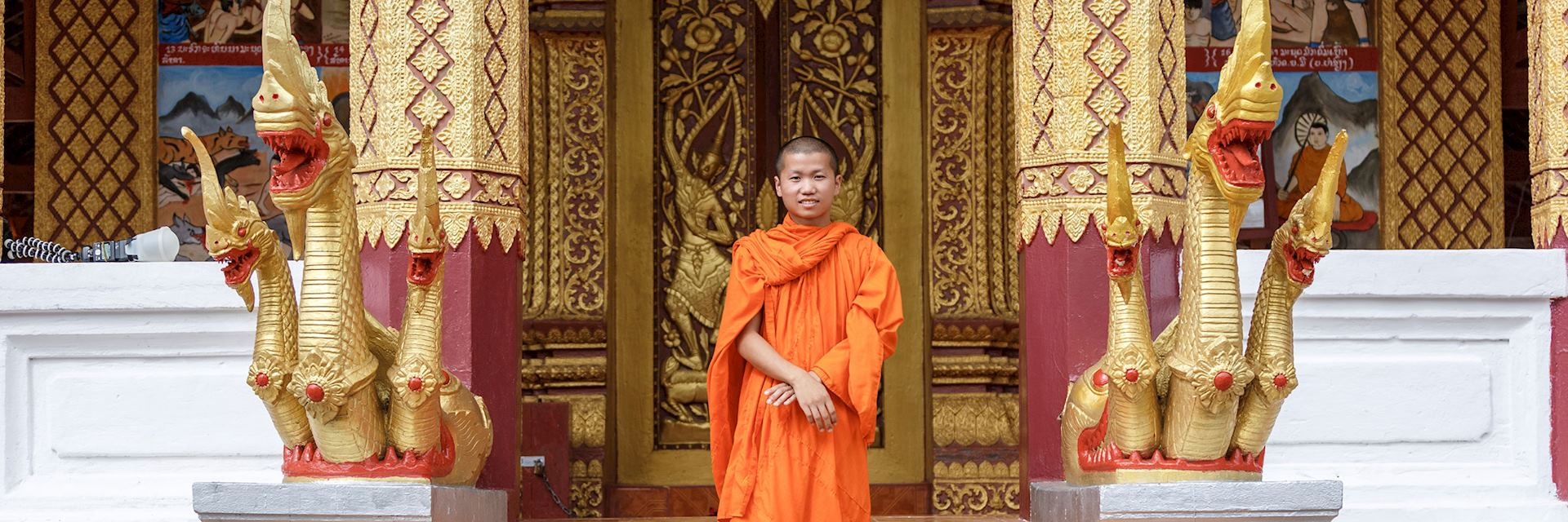 Buddhist monk in font of a monastery, Laos