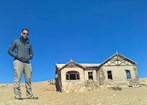 Anthony at the deserted ghost town of Kolmanskop, Namibia