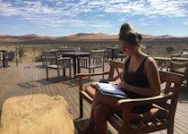 Déanna reading at Kulala Desert Lodge in Sossusvlei, Namibia