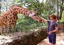 Jack with a giraffe in Kenya