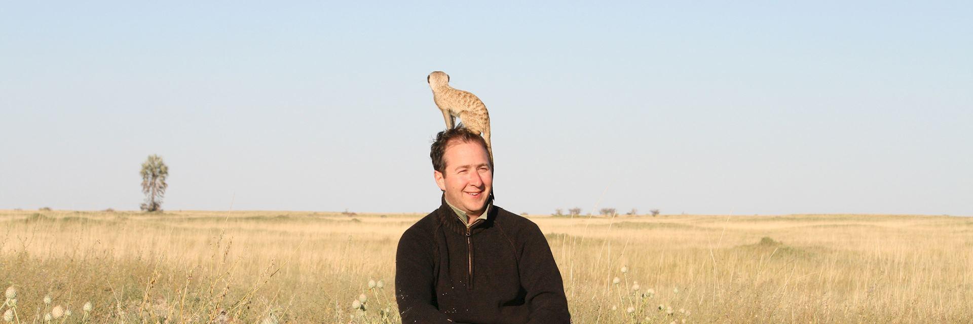 James shows off his new meerkat hat, Botswana