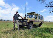 Mark on a game drive in the Masai Mara National Reserve, Kenya