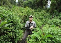 Mark pausing for breath trekking the gorillas in Volcanoes National Park, Rwanda