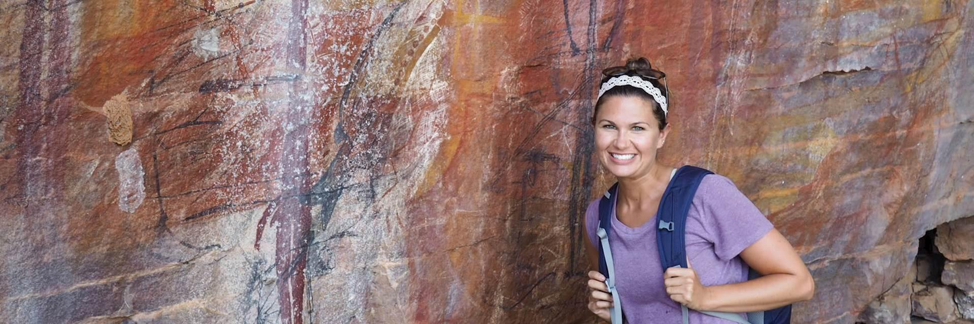 Rachele viewing ancient rock art in Arnhem Land, Northern Territory