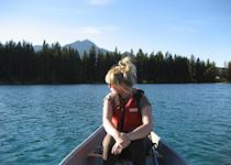 Anna canoeing on Beauvert Lake, Canada