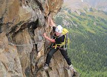 Anna climbing a via ferrata in the Rocky Mountains, Canada