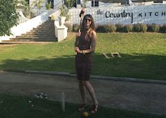 Charlotte playing croquet in Franschoek, South Africa