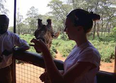 Holly at the giraffe sanctuary outside Nairobi, Kenya