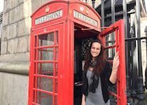 Marissa in a red telephone box in London