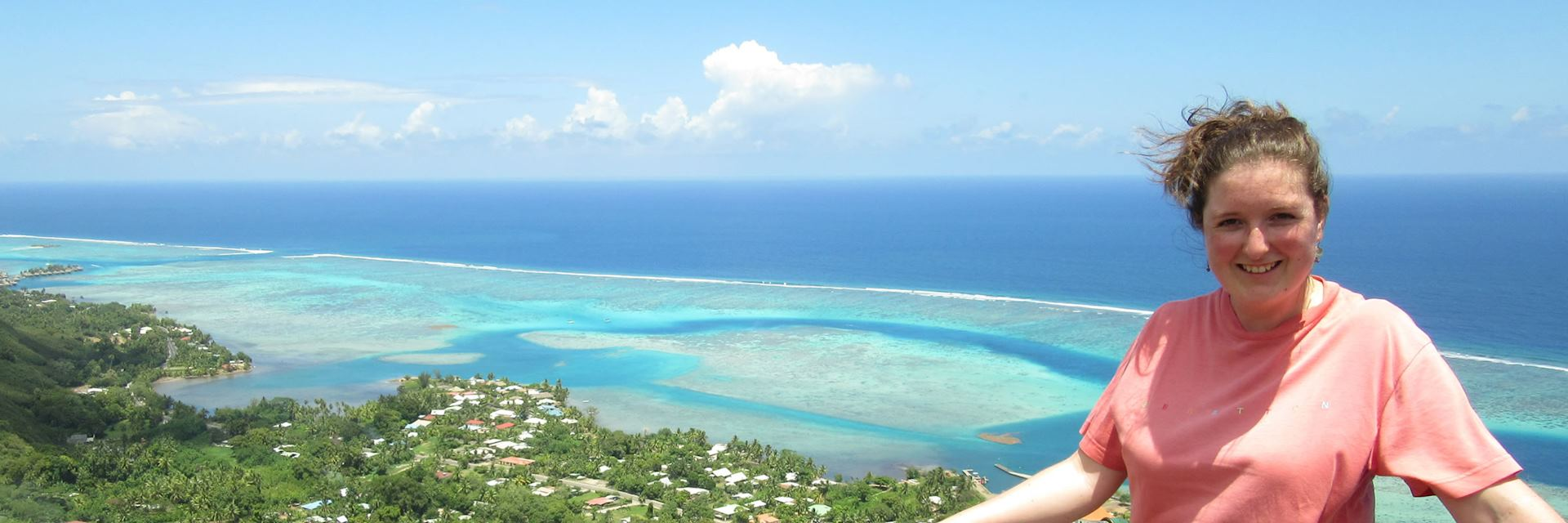 Annabel on top of Magic Mountain looking at the lagoons of Mo'orea, French Polynesia