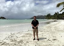 Chris on the beach at Paradise Sun, Praslin, the Seychelles