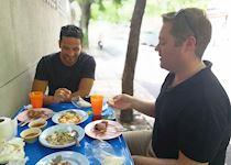 Daniel with an Audley colleague eating n Bangkok, Thailand