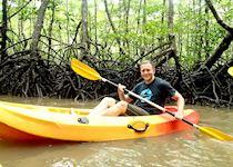 Matt kayaking through the mangroves in Sabah, Borneo