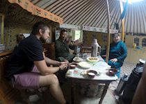 Matt with a local family in a traditional ger in Mongolia