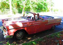 Caroline in a classic car in Cuba