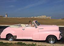 Corina in a classic American car, Cuba