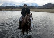 Iain horse riding in Torres Del Paine, Chile