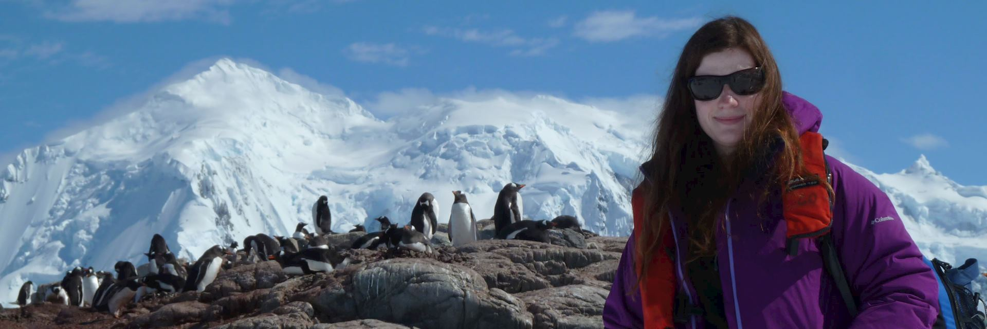Lizzie with penguins in Antarctica