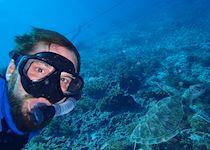 Nik diving in Ambergis Caye, Belize