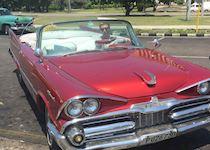 Sean in a classic American car in Havana, Cuba