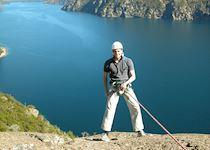 Tom abseiling over Lake Nahuel Huapi, Bariloche, Argentina