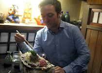 Rory eating local Takayama cuisine in Japan