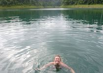 Charlotte swimming in the lake at Rainforest Camp in Khao Sok National Park, Thailand