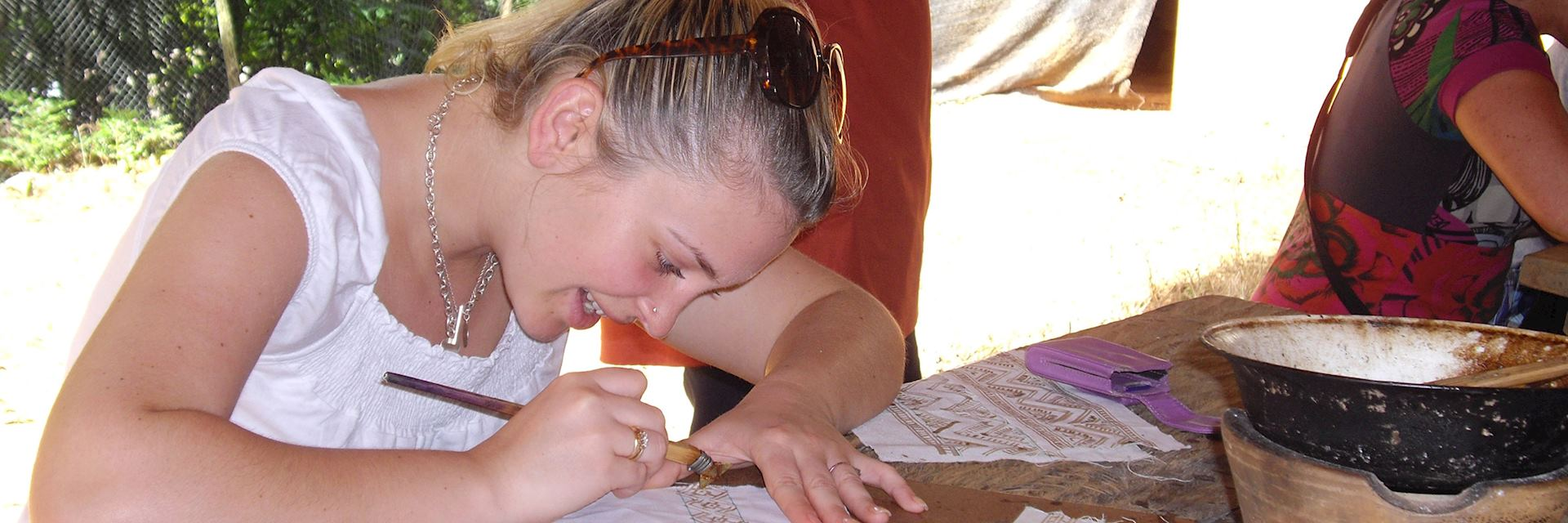 Charlotte making a traditional Hmong batik handkerchief, Thailand