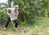 Ellie planting a tree as part of a community project for Abai Village, Kinabangan River, Borneo