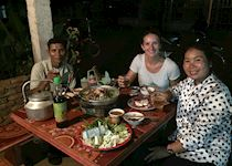 Hayley with a local family in Champasak, Laos