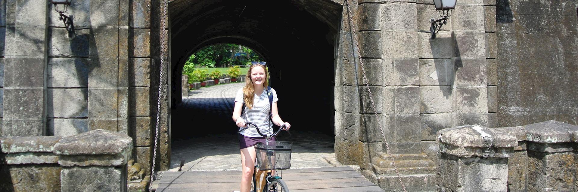 Isabel riding through Intramuros, Manila