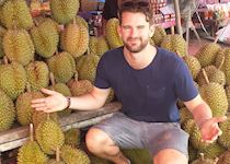 Mat amongst some pungent durian fruit in a market near Koh Samet, Thailand